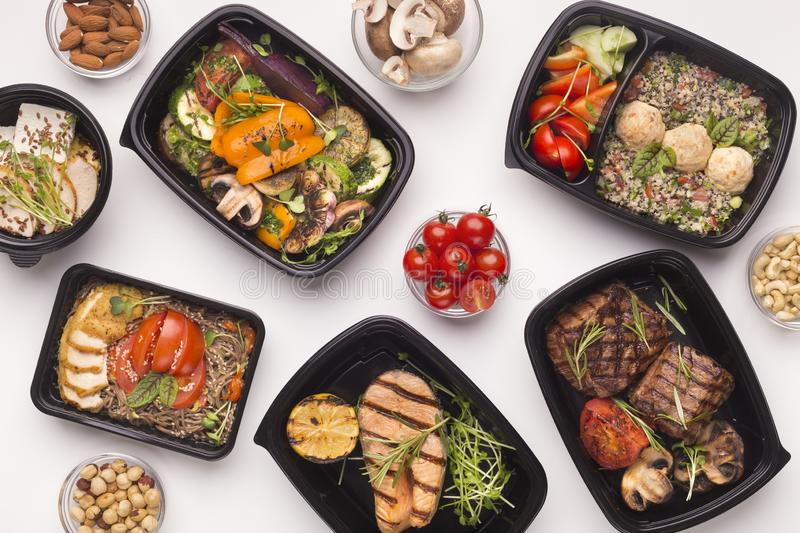 Restaurant healthy food delivery in take away boxes royalty free stock image