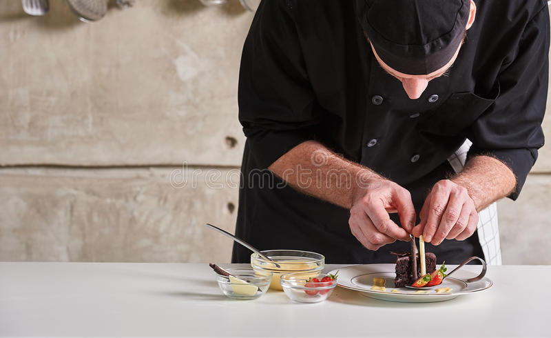 Restaurant hotel private chef preparing dessert chocolate cake royalty free stock photos