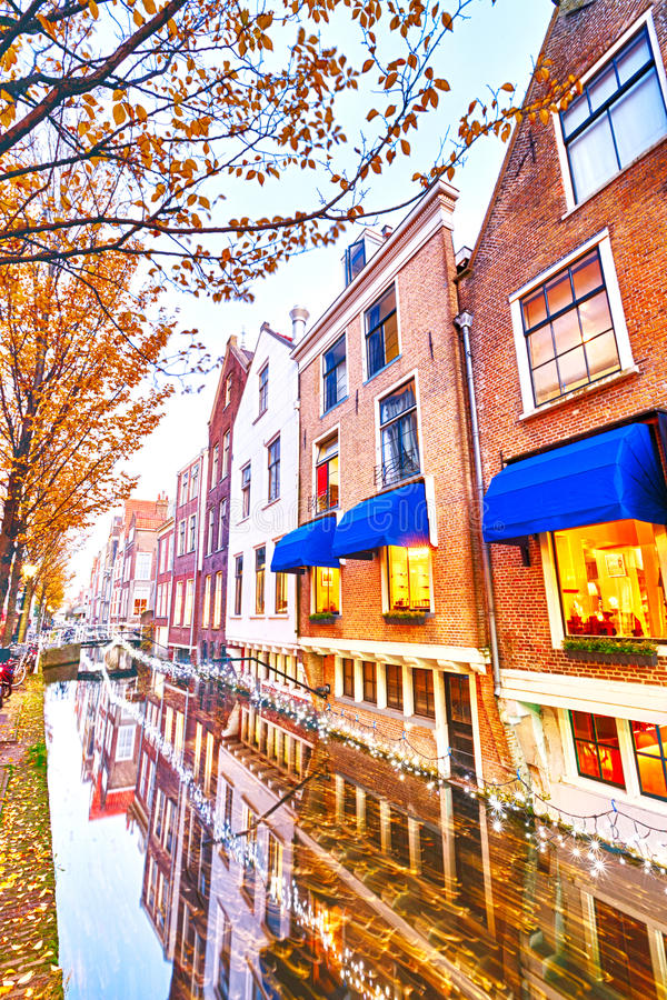 Restaurant and houses near a water canal stock images