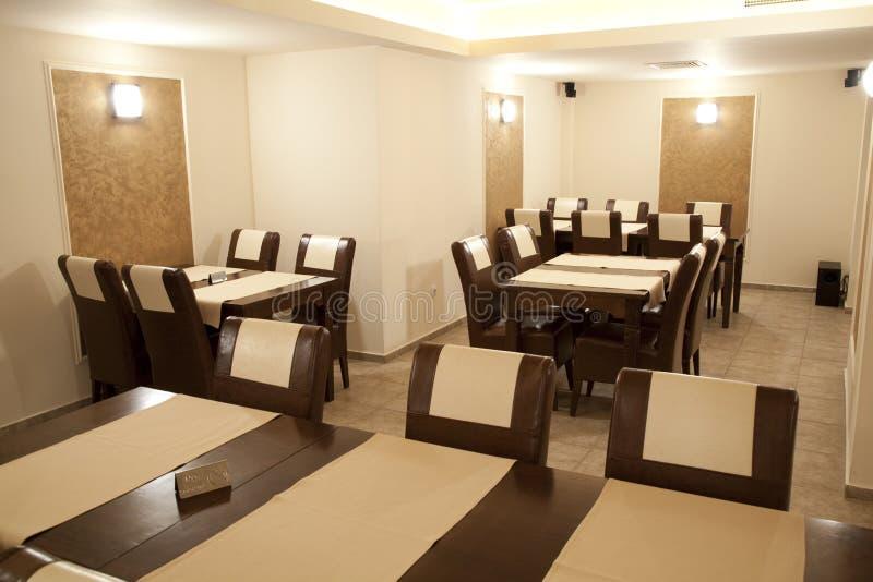 Restaurant interior. Modern restaurant empty in brown elegant style royalty free stock images