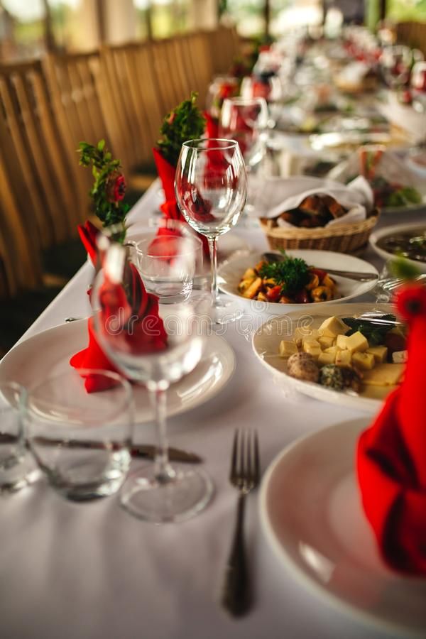 Restaurant interior, serving, wine and water glasses, plates. Concept banquet, birthday, conference, group lunch stock image