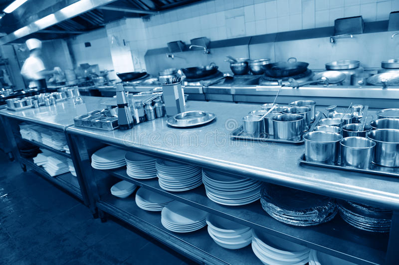 Restaurant kitchen. Motion chefs of a restaurant kitchen stock photography