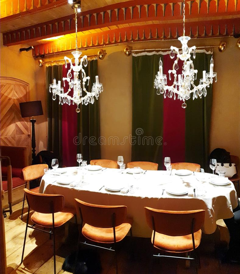 Restaurant. Luxery chandelier red green glass table indoor modern royalty free stock photography
