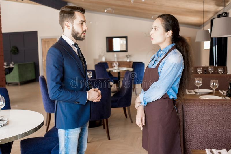 Restaurant manager working with service personnel stock image