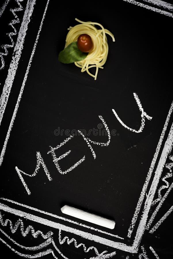 Restaurant menu on chalkboard royalty free stock photography