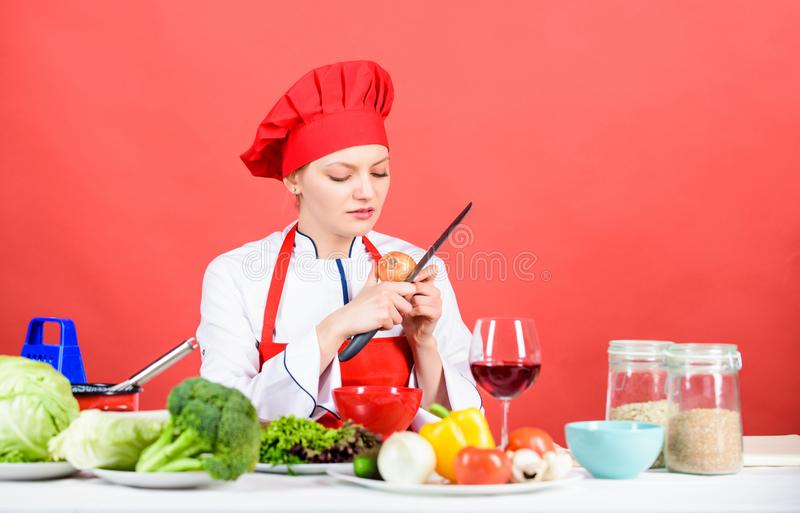 Restaurant menu. Dieting. happy woman cooking healthy food by recipe. professional chef on red background. organic stock photo