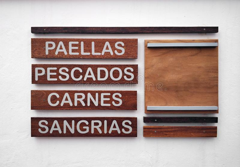 Restaurant menu in spanish on a white wall stock image