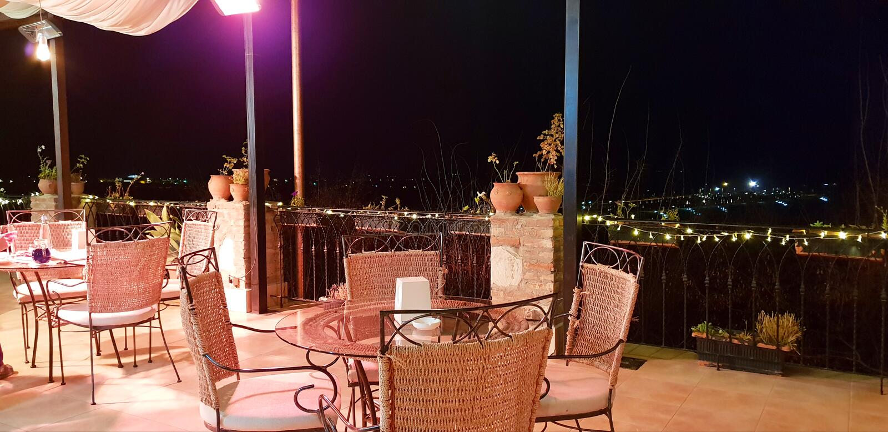 Restaurant. Night restaurant tables balcony pots terrace light cosy design luxery stock image