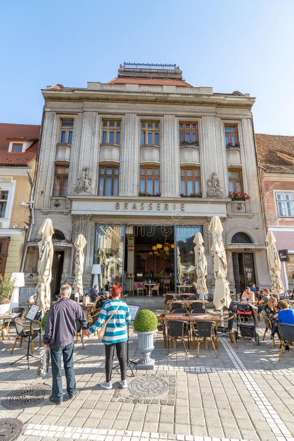 Restaurant in an old mansion on the central square of the old Brasov in Romania. One of the ten largest cities in Romania. Located in the heart of Romania, the royalty free stock photography
