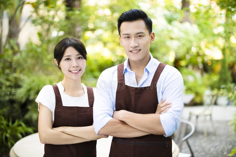 Restaurant owner standing with partner. Garden restaurant owner standing with partner royalty free stock photography