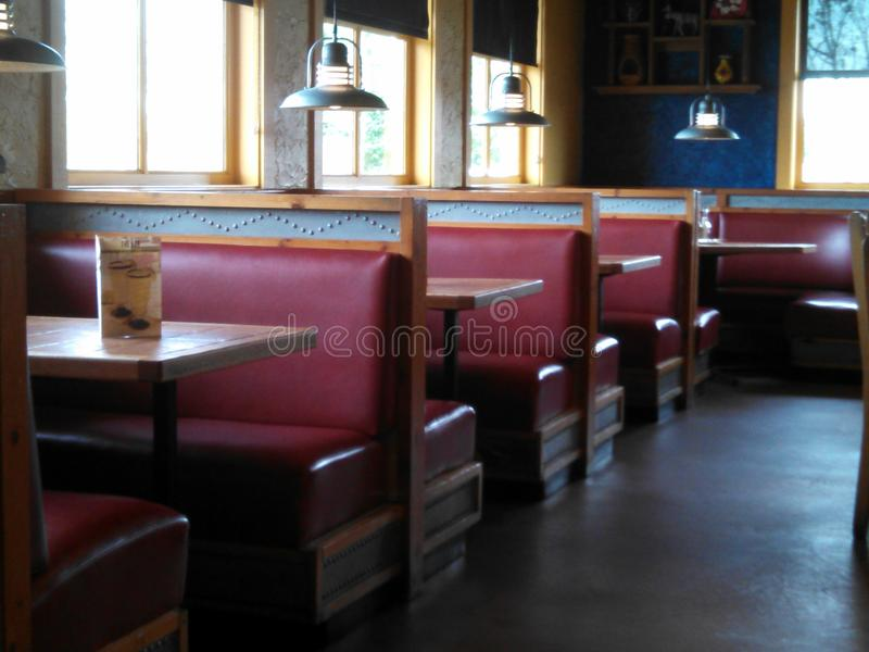 Restaurant with red booths. Interior of a restaurant with red booths royalty free stock photography