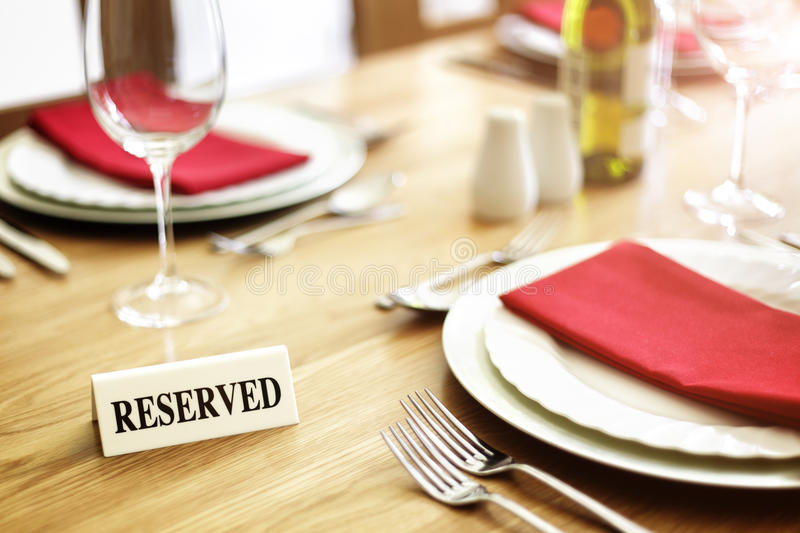 Restaurant reserved table sign stock photos