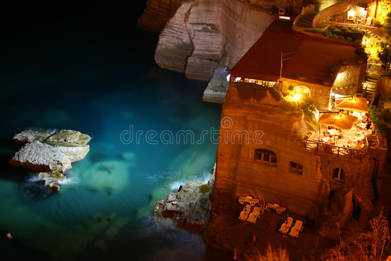 Restaurant on the sea by night royalty free stock photos