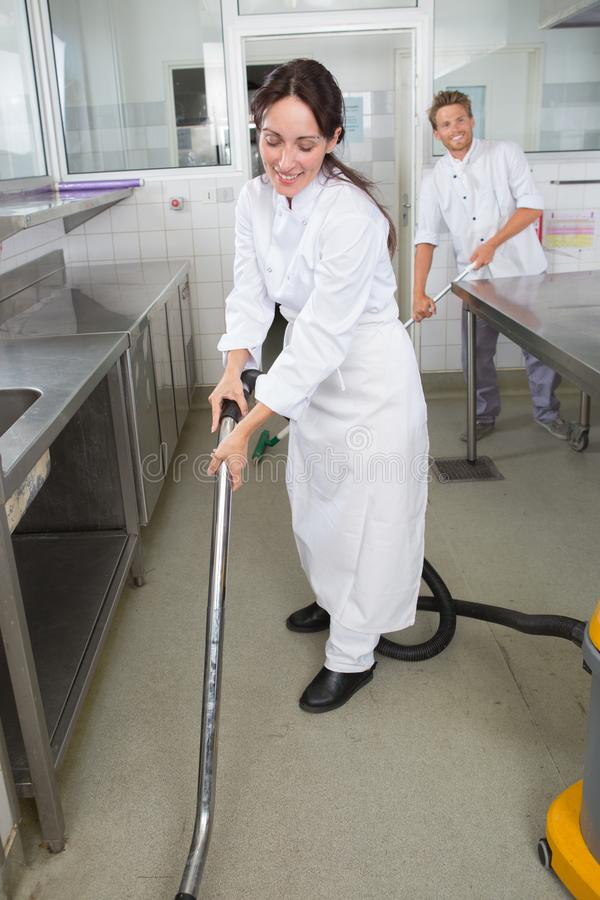 Restaurant staff cleaning kitchen floor. Cleaning stock images