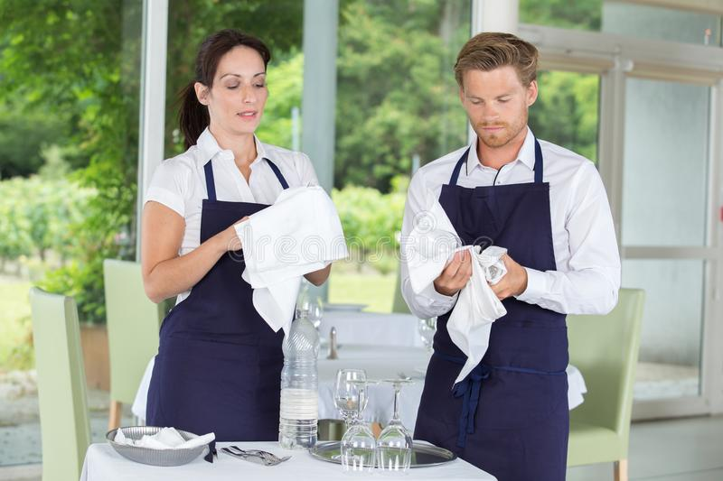 Restaurant staff cleaning wine glasses. Staff royalty free stock image