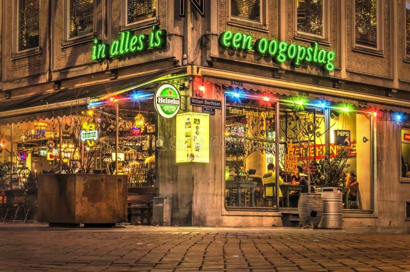 Restaurant on a street corner at dusk stock photos