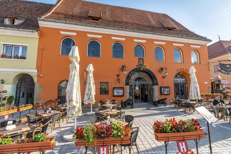 Restaurant in the street of old Brasov in Romania. One of the ten largest cities in Romania. Located in the heart of Romania, the city of Brasov is sometimes stock photography