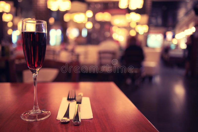 Restaurant table with glass of wine. Italian restaurant with glass of wine stock images