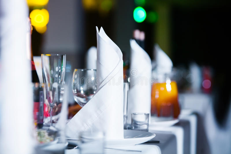 Restaurant table with glasses and napkins. Served restaurant table with glasses and napkins royalty free stock images