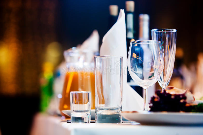 Restaurant table with glasses and napkins. Served restaurant table with glasses and napkins stock photo