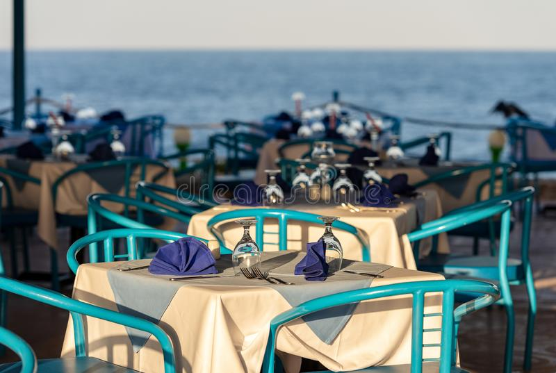 Restaurant with Table Set for Dinner - Red Sea Egypt. Restaurant patio with table set for dinner in a tourist resort near Marsa Alam, Red Sea, Egypt, Africa royalty free stock photos