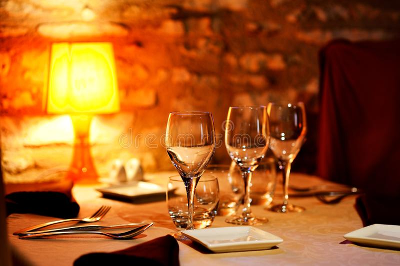 Restaurant table with a set of empty glasses royalty free stock images