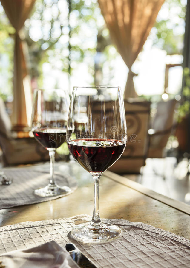 Restaurant table with wine glasses. Restaurant table with two glass of red wine stock images