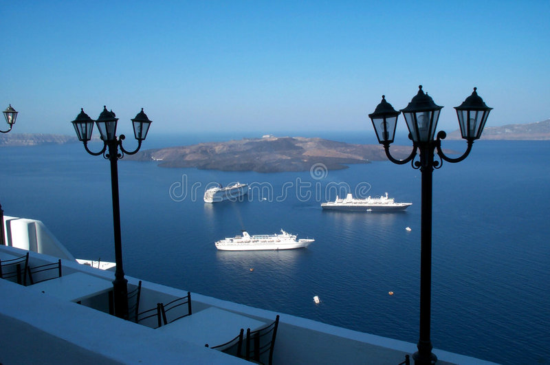 Restaurant tables. Cruiserships in the background royalty free stock image