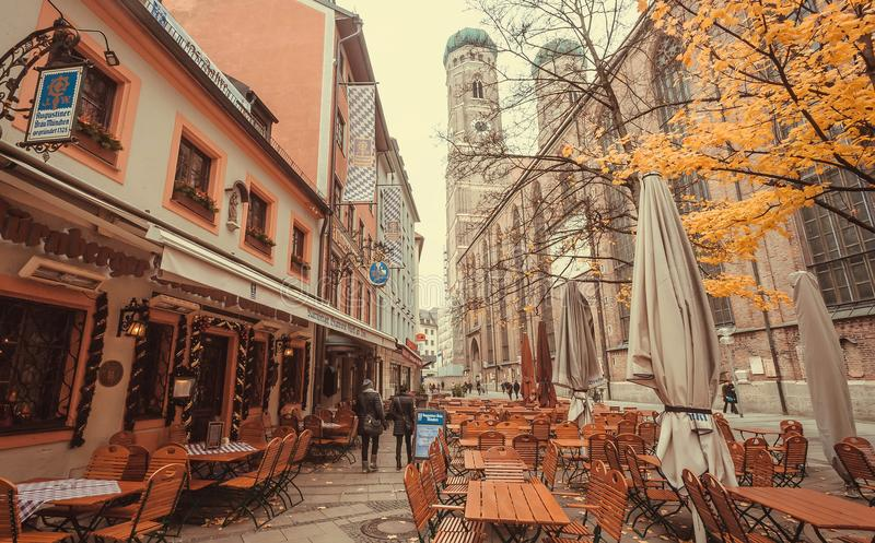 Restaurant tables, stores and 15th century Frauenkirche church stock photos