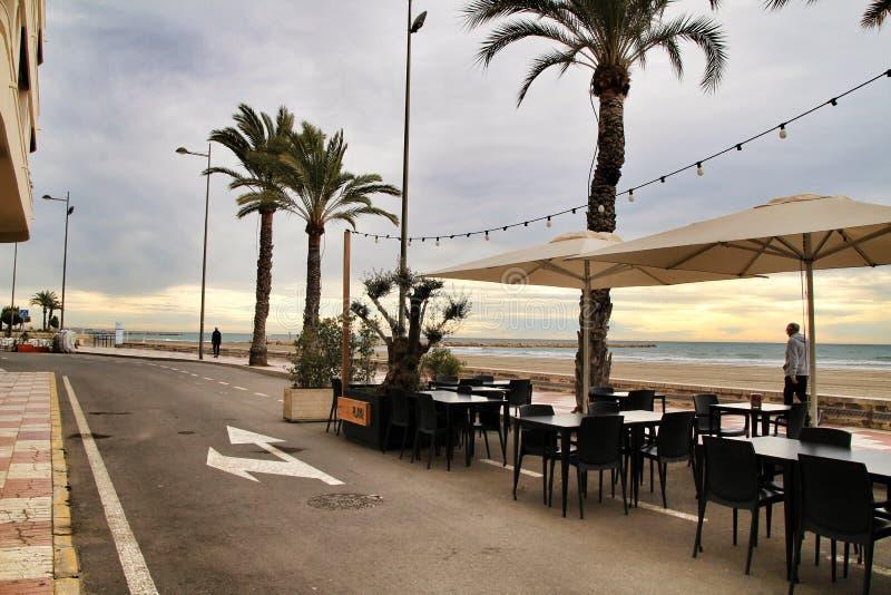 Restaurant with terrace on Santa Pola beach. Santa Pola, Alicante, Spain- January 31, 2019: Restaurant with empty terrace on Santa Pola beach in a stormy day stock photography