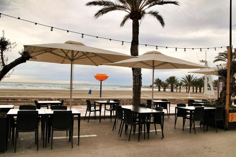 Restaurant with terrace on Santa Pola beach. Restaurant with empty terrace on Santa Pola beach in a stormy day royalty free stock photography