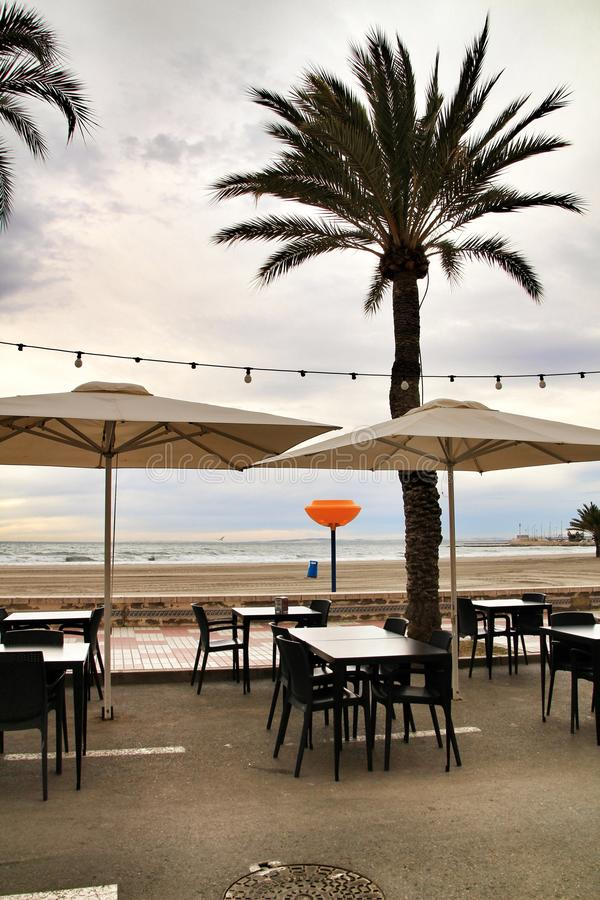 Restaurant with terrace on Santa Pola beach. Restaurant with empty terrace on Santa Pola beach in a stormy day stock image