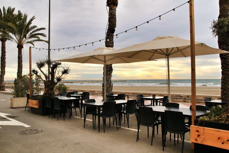 Restaurant with terrace on Santa Pola beach. Restaurant with empty terrace on Santa Pola beach in a stormy day stock photos