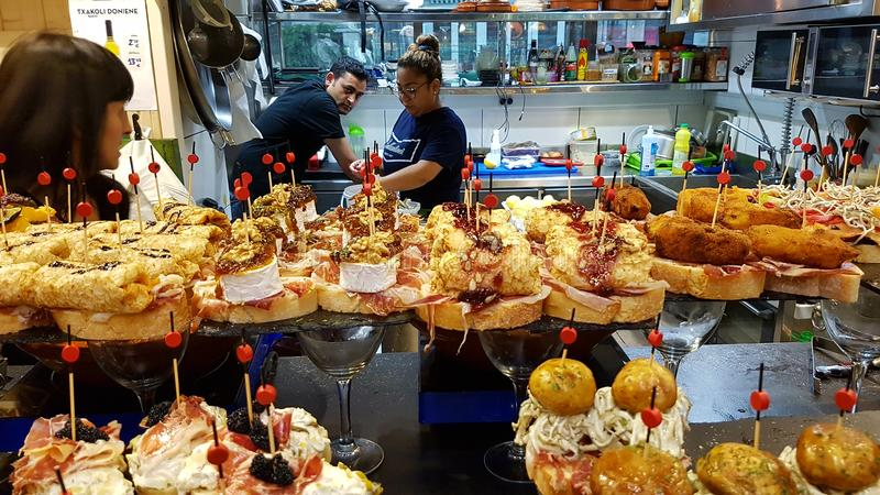 Restaurant table with pinchos in Bilbao stock photography