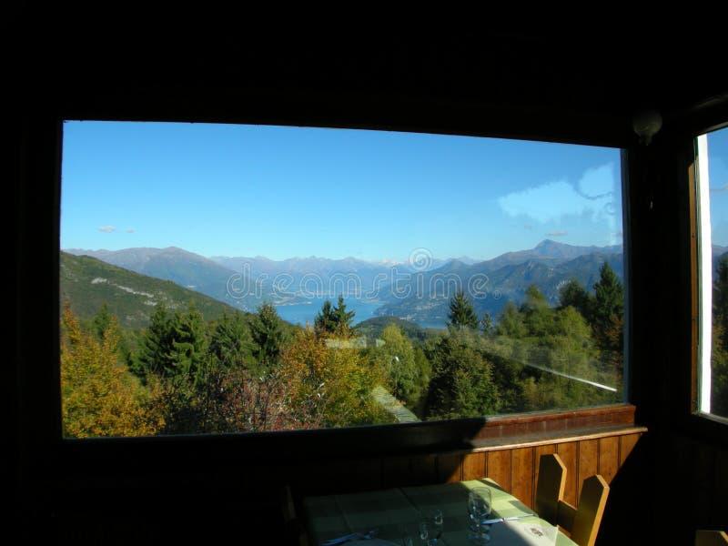 restaurant view Como with alps Italy stock photos