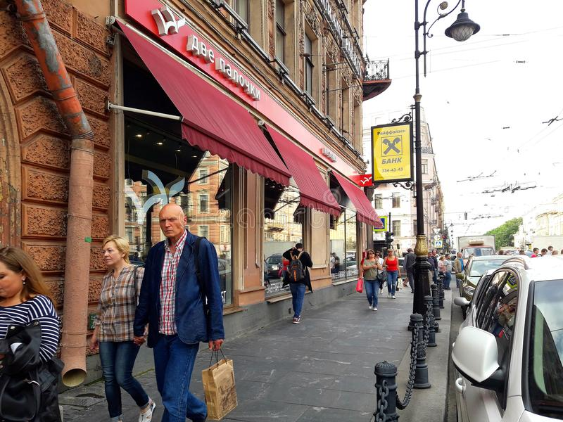 Restaurant and walking people in the European city Saint Petersburg, Russia stock images