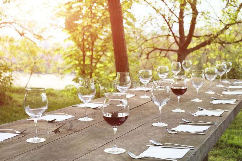 Restaurant wine glasses on a wooden table royalty free stock image