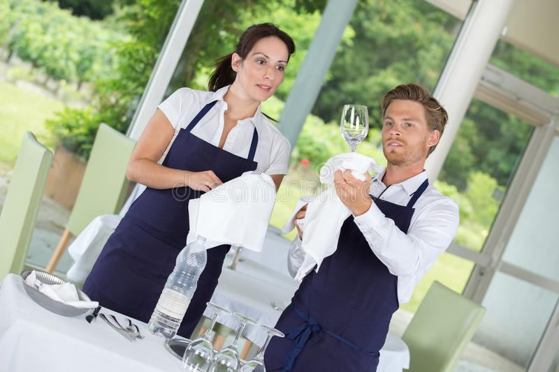 Restaurant workers cleaning glasses. Cleaning royalty free stock image
