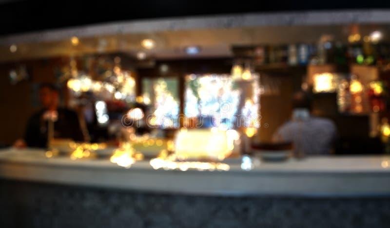 Restaurante del café de la falta de definición con el fondo abstracto de la imagen de la luz del bokeh foto de archivo libre de regalías