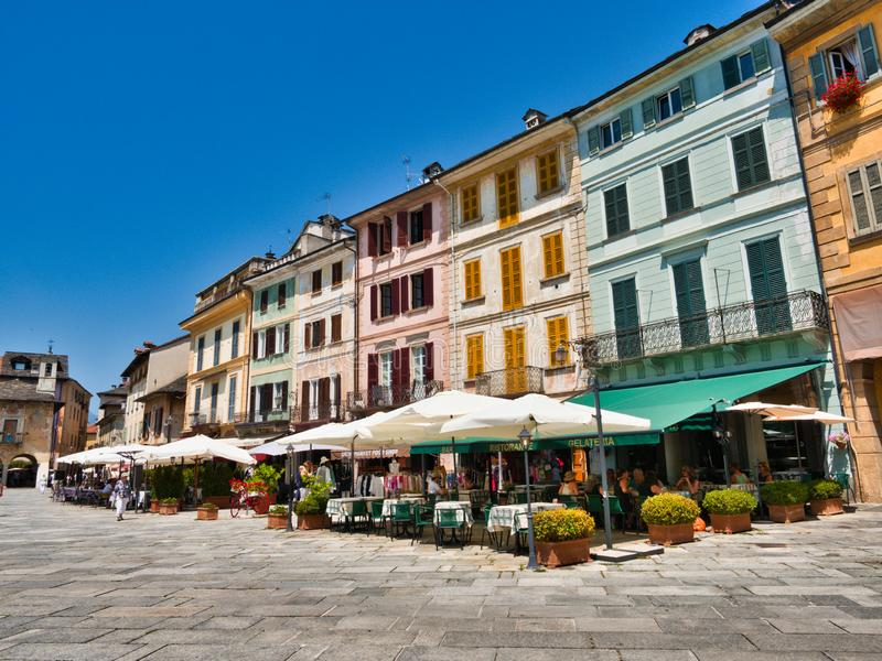 Restaurants and local businesses in Piazza Motta in the village of Orta San Giulio italy during a summer morning. Orta San Giulio, Lake Orta, Italy - June 29 stock photography