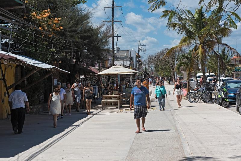 Restaurants and tourists on avenida tulum, tulum, quintana roo, mexico.  royalty free stock images