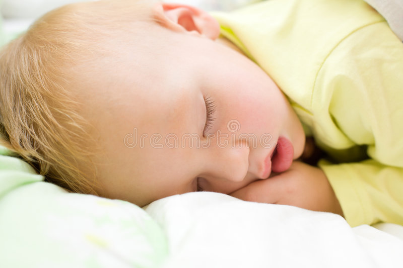 Restful Baby Boy Sleeping On Bed Royalty Free Stock Image