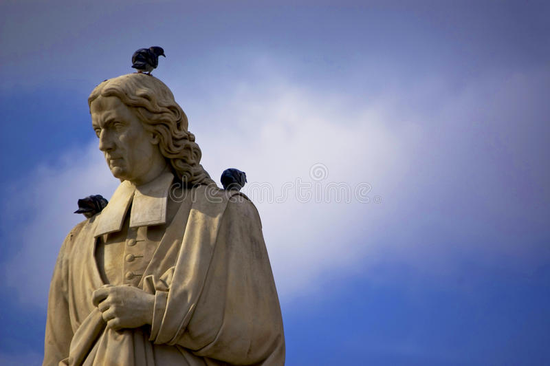Resting. Birds on a statue in Italy royalty free stock images