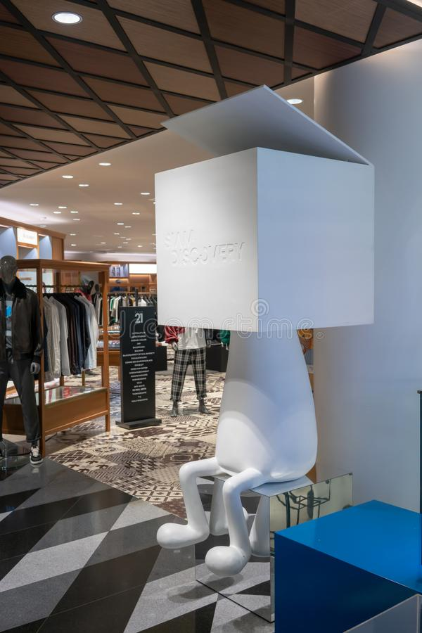 Resting corner interior in clothing department at Siam Discovery. Bangkok, Thailand, Apr 11, 2018 : White character design with little opened cube box head for royalty free stock images