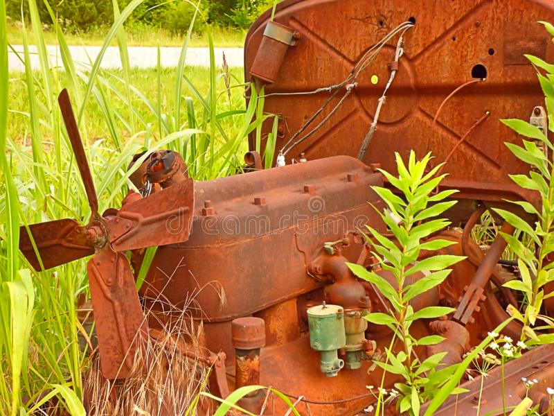Resting engine from an abandoned auto in a field royalty free stock photo