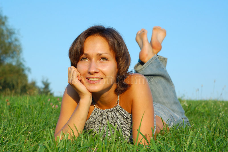 Resting girls. Girl resting on the green meadow royalty free stock photos