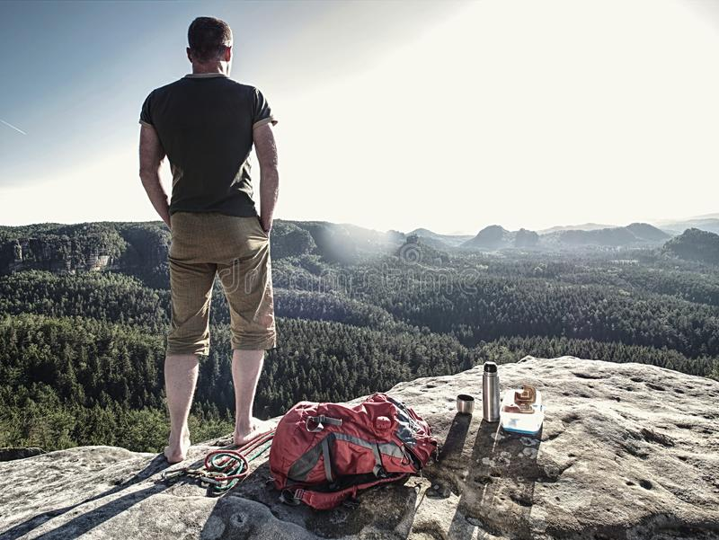 Resting man stay without shoes on view point. Tourist brink royalty free stock photography