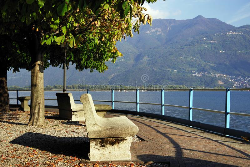Resting place on the shores of Lake Iseo in autumn. Lago d`Iseo or Sebino is the fourth largest lake in Lombardy, Italy, fed by the Oglio river. It is in the stock image