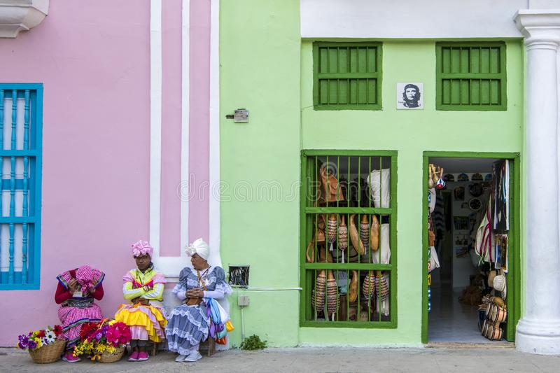 Resting street entertainers - women traditional costumes, Havana, Cuba royalty free stock image
