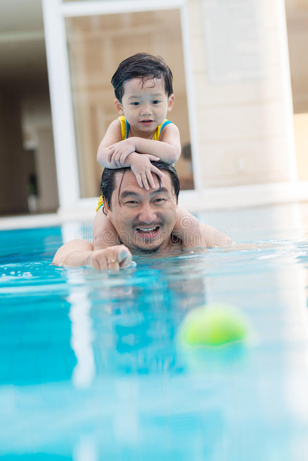 Resting in swimming pool royalty free stock image
